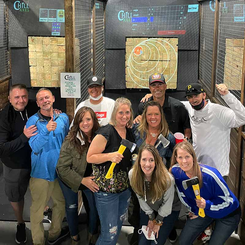 Group of friends enjoying an axe throwing event at Chill Axes in Anne Arundel County, Maryland.